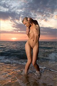 Babes: young blonde girl in the sea at sunset