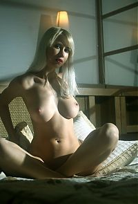 Babes: young blonde girl shows off her body in the bedroom