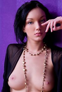 Babes: cute young black haired girl with a golden necklace