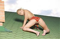 Babes: cute young blonde girl on the roof of the house
