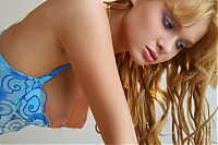 Babes: young golden blonde girl reveals her lingerie in the bed