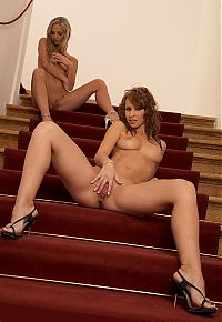 Babes: two girls show off their bodies on stairs