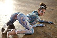 Nake.Me search results: young brunette girl with body painting shows off on the floor