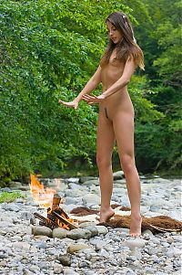 Babes: young brunette girl in the nature with a campfire