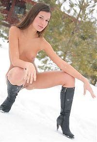 Babes: cute young brunette girl posing in boots outside in the winter