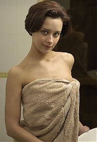 Babes: brunette girl in the bathroom with a towel