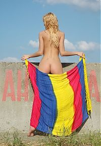 Babes: blonde girl with the colorful scarf at the river dam