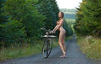 Babes: blonde girl with pigtails on the road with a bicycle and umbrella