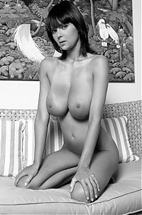 Babes: young black and white girl with big natural breasts on the couch