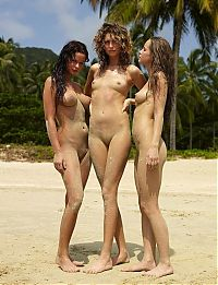 Nake.Me search results: three young girls posing in the sand on the beach
