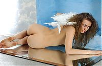 Nake.Me search results: young curly brunette girl shows off in the mirrors with angel wings