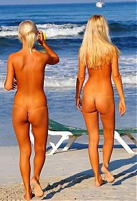 Babes: two blonde girls wearing extreme bikini on the beach at the sea