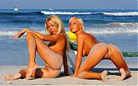 Nake.Me search results: two blonde girls wearing extreme bikini on the beach at the sea