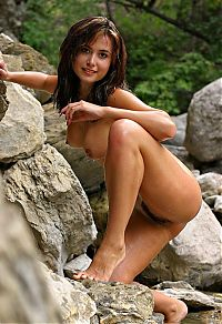 Nake.Me search results: young brunette girl shows off on rocks with a mountain stream nearby