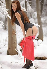 Nake.Me search results: young red haired girl strips to black stockings in the winter forest