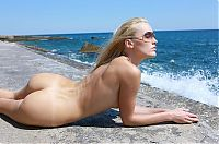 Nake.Me search results: young blonde girl with sunglasses at the sea shoreline