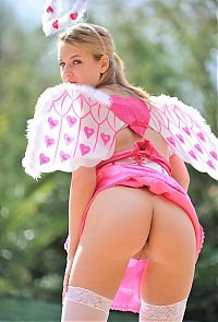 Nake.Me search results: blonde girl wearing a costume with angel wings and stockings with little pink hearts