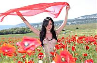 Babes: young black haired girl outside on the field with red poppies