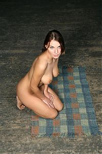 Babes: brunette girl posing on the floor with the runner rug and the old red chair