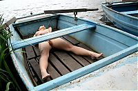 Nake.Me search results: brunette girl posing in the old boat