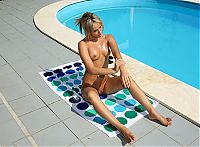 Nake.Me search results: blonde girl on the towel strips her bikini and sunbathing at the swimming pool