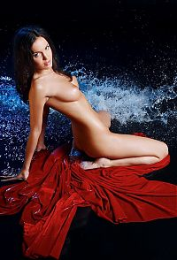 Nake.Me search results: young brunette girl with a red textile sheet getting wet in the studio