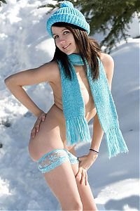 Nake.Me search results: young brunette girl reveals in a blue wool hat, scarf and panties outside in the winter