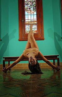 Nake.Me search results: brunette girl doing gymnastic exercises in the church with stained glass windows