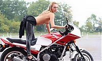 Nake.Me search results: blonde girl undresses her leather overall on the honda motorcycle