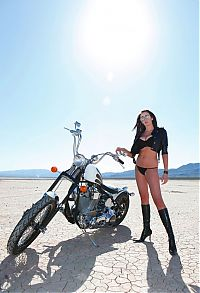Nake.Me search results: red haired girl with sunglasses and black boots posing on a motorcycle in the desert