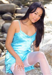 Nake.Me search results: young asian girl reveals at the rocks of the mountain stream with a cyan negligee and white stockings
