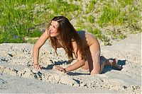 Nake.Me search results: young brunette girl reveals on the sand at the lake