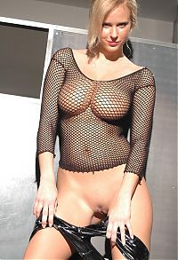 Nake.Me search results: blonde girl with big breasts reveals her black fishnet top and latex shorts
