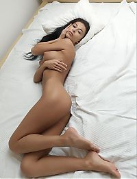 Nake.Me search results: young brunette girl shows off her body on the bed with white sheets