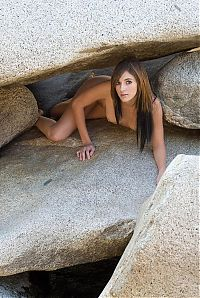 Nake.Me search results: young hair colored brunette girl undresses her panties under the rocks at the creek natural stream
