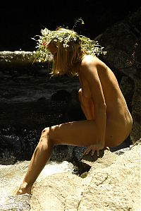 Nake.Me search results: blonde girl with a floral wreath outside in the nature at the waterfall