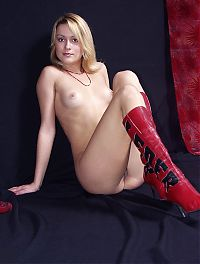 Nake.Me search results: young blonde girl reveals her red robe and boots in the studio