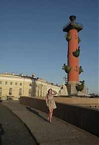 Nake.Me search results: young brunette girl reveals her coat at the rostral column lighthouse in the city of saint petersburg