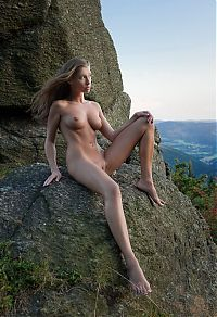 Nake.Me search results: cute young blonde girl with a navel piercing posing naked on rocks in high mountains