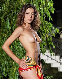 Babes: cute young curly brunette girl reveals with a scarf in the backyard garden