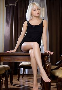 Nake.Me search results: cute young grey blonde girl reveals her black camisole and high heels on the table at home