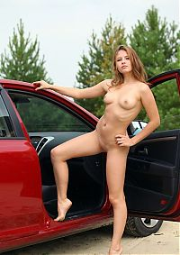 Nake.Me search results: young brunette girl posing naked outside at the red car