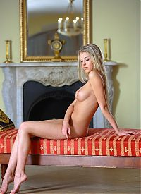 Babes: young blonde girl with blue eyes reveals her purple top on the chaise longue récamier