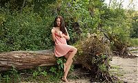 Nake.Me search results: young brunette girl reveals her pink dress at the uprooted tree windthrow
