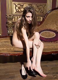 Nake.Me search results: young brunette girl reveals her black panties and high heels on the antique chaise longue méridienne
