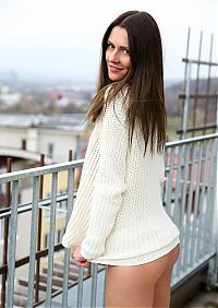 Babes: young brunette girl reveals her white sweater and white thongs on the roof