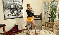 Nake.Me search results: young blonde girl reveals her undergarments in the studio with a guitar and microphone